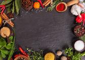 Various spices on black stone — Stock Photo