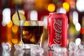 Prague, CZECH REPUBLIC - MAY 11, 2015 : Can of Coca-Cola with glass on ice cubes. Coca-Cola is the one of the worlds favourite soft drinks. — Stock Photo