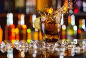 Glass of cola drink on bar counter — Stock Photo
