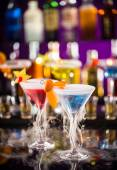 Martini drinks served on bar counter — Stock Photo