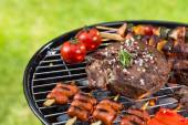Barbecue grill with various kinds of meat — Stock Photo