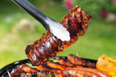 Delicious ribs on grill — Stock Photo