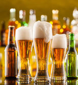 Jugs of beer served on bar counter — Stock Photo