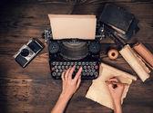 Retro typewriter on wooden planks — Fotografia Stock