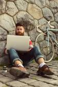 Trendy hipster young man with laptop — Zdjęcie stockowe