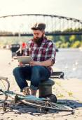Trendy hipster young man with tablet — Stock Photo