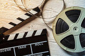 Film camera chalkboard and roll — Stock Photo