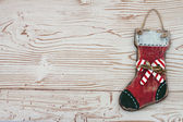Christmas Background with a Stocking on Grunge Textured Wood Bac — Stock Photo