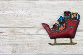Christmas Background with a Santa Sleigh on Grunge Textured Wood — Stock Photo