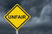 Unfair Caution Road Sign — Stock Photo