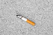 Cigarette on ground — Stock Photo