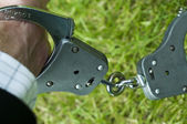 Man in handcuffs outside — Stock Photo