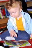 Baby reading — Stock Photo