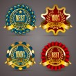 Golden badges with laurel wreath — Stock Vector #67871247