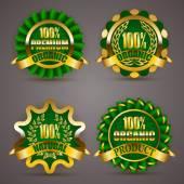Zlaté odznaky s vavřínový věnec — Stock vektor