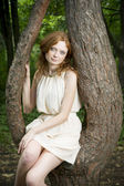 Portrait of redhead girl on nature — Stock Photo