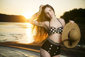 Beautiful woman in bikini on sunset background — Stock Photo