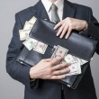 Businessman with a briefcase full of money in the hands of — Stock Photo #57984745
