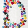 Letter D of the alphabet of buttons of various shapes and colors — Stock Photo #57986505