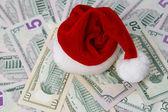 Santa hat on a background of money — Stock Photo