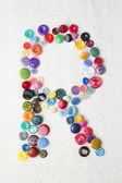 Literą R alfabetu przyciski różne kształty i kolory — Zdjęcie stockowe