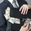Businessman with a briefcase full of money in the hands of — Stock Photo #58482303