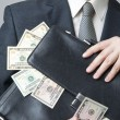 Businessman with a briefcase full of money in the hands of — Stock Photo #60973703