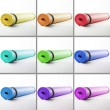 Colored mats for fitness on a white background. — Stock Photo #67774877