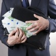 Businessman with a briefcase full of money in the hands of — Stock Photo #71569167