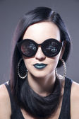 Beautiful woman fashion model portrait in sunglasses with blue lips and earrings. Creative hairstyle and make up — Stock Photo