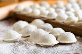 Domestic raw dumplings on the table — Stock Photo
