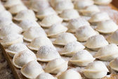 Domestic raw dumplings on the table,selective focus — Stock Photo