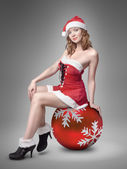 Beautiful girl dressed as Santa's helper — Stock Photo