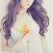 Beautiful lady with orchid — Stock Photo #68869377