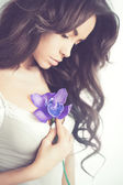 Beautiful lady with orchid — Stok fotoğraf