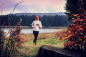 Jogging by the lake — Stockfoto