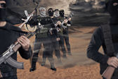 Militants with firearms — Stock Photo