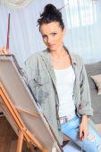 Female painter at work — Stock Photo