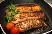 Fresh salmon filles  grilled in a pan — 图库照片