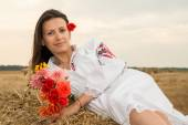 Young woman with national costume from Bulgaria — Stockfoto