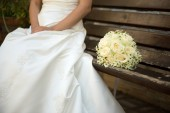 Bride with a wedding bouqet -  selective focus — Stock Photo