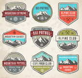 Mountain Grunge color Vector insignias — Wektor stockowy