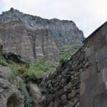 The wall and the mountain in Geghard monastery, Armenia — Stock Photo #53995515