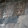 Carved crosses in a row on the wall of Geghard monastery — Stock Photo #54909483