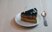 Piece of chocolate cake on a caucer — Stock Photo