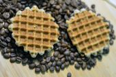 Two round waffles on coffee beans — Stock Photo