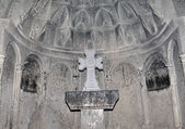 Cross on the alter of church of Geghard monastery — Stock Photo