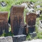 Group of three hachkar stones next to Sevanavank monastery — Stock Photo #69281641