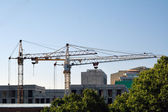 Two cranes and buildings under construction — Stock Photo