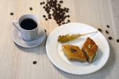 Two pieces of baklava, sugar and hot coffee — Stock Photo